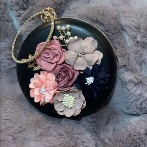 Black clutch with floral accents